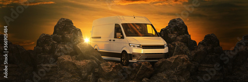 Fotografía commercial delivery vans against sunset and mountains