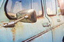 Rear View Mirror Of An Old Rusty Turquoise Car