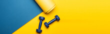 Top View Of Blue Fitness Mat With Dumbbells On Yellow Background, Panoramic Shot
