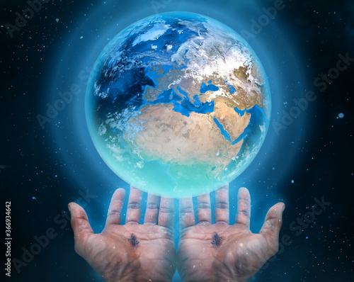 Photo Hands of Jesus holding the earth