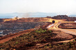 canvas print picture - Open pit mine in Madgascar, with huge crane and trucks ro bring ore to a processing plant