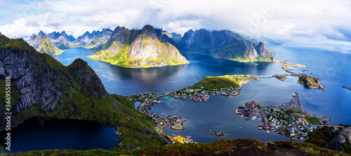 Fényképezés Sunny aerial panoramic view on stunning mountains and village of Reine in Lofoten islands, Norway from Reinebringen ridge