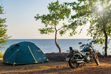 Motor Bike And Tent At The Sea...