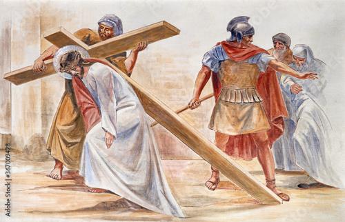 Fotomural BARCELONA, SPAIN - MARCH 5, 2020: The fresco Simon of Cyrene helps Jesus carry the cross in the atrium of church Església de la Concepció from 19