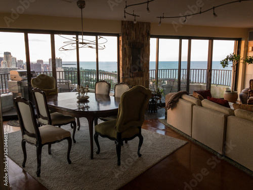 dining room with view of Lake Michigan and highrises in Chicago, Illinois Wallpaper Mural