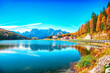 Fantastic sunny view of famous Misurina lake during autumn period