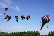Colored Kites Hover In The Air.