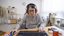 Funny Young Female Gamer With ...