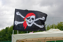 Pirates Skull And Crossed Bones Flag Flying.