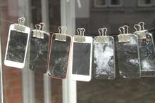 A Lot Of Broken Smartphones On...