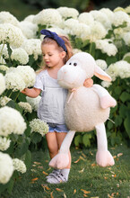 Little Girl With A Plush Toy S...