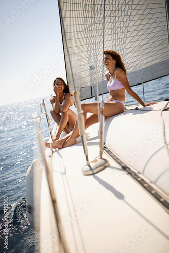 Young girls relax on a yacht