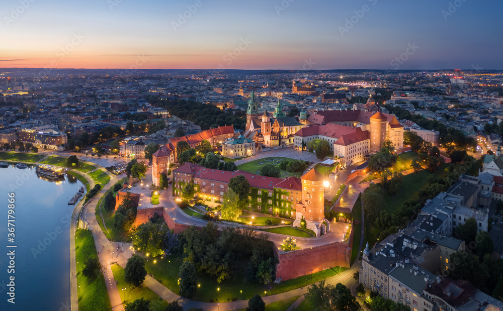 Fototapeta Krakow, Poland. Aerial view of illuminated Wawel Royal Castle on sunset