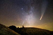Night Landscape Of Mountains With Stars Covered Sky And C/2020 F3 (NEOWISE) Comet With Light Tail.