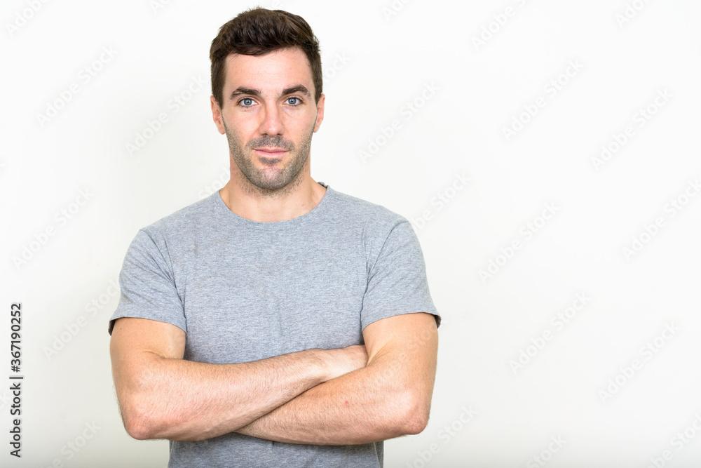 Fototapeta Portrait of handsome Hispanic man with beard stubble
