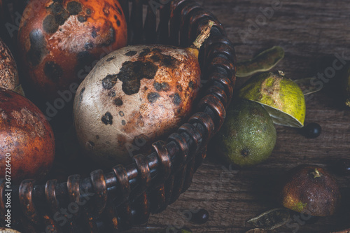 Tablou Canvas Still Life with Rotten Fruits, detail of wicker basket on wooden table