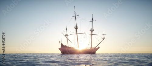 Fototapeta Sailing vessel sailing in the ocean with sunset.