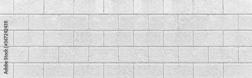 Panorama of Outdoor white stone block wall seamless background and pattern texture