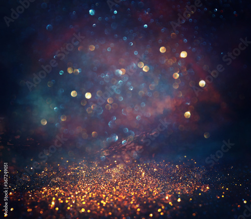 background of abstract glitter lights. gold, blue and black. de focused - 367249051