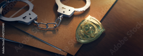 Valokuvatapetti Police officer badge with handcuffs on a dark background ( 3D rendering, illustr
