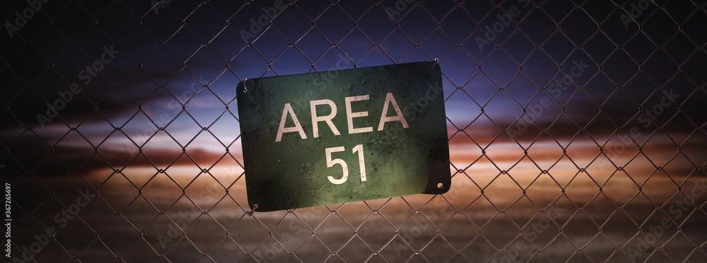 Fototapeta  Area 51 sign on a fence at dusk. (3D Rendering, illustration)