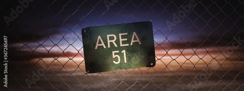 Fotomural Area 51 sign on a fence at dusk. (3D Rendering, illustration)