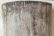 Side View Of A Cracked Log On A Parquet Ground. Old Wood Texture Background.