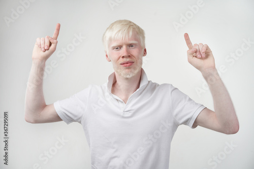Tablou Canvas albinism albino man in studio dressed t-shirt isolated on a white background