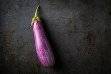 Fairy Tale Eggplants On A Dark...