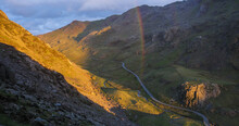 Scenic View Of Llanberis Pass With Rainbow