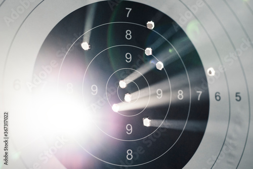 Photo Shooting target with light coming out of holes