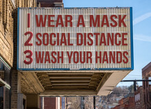 Mockup Of Movie Cinema Billboard With Wear A Mask, Social Distance And Wash Hands To Deal With The Coronavirus Epidemic.