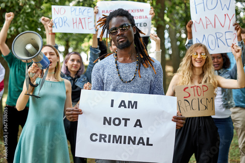 Valokuva diverse american people took to the public park and streets to protest anti-black racism and police brutality