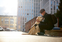 Handsome Blind Guy Have Rest With Golden Retriever In The City, Young Male Sit With Guide Dog, Love Him, Dog Assist Him While Walking