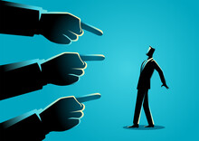 Businessman Being Pointed By Giant Fingers