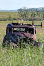 Old Rusty Abandoned Car In A F...