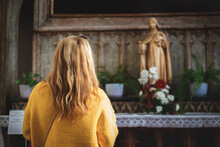 Woman Praying To Virgin Mary In Church. Faith And Hope Concept
