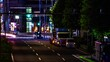 A night timelapse of the urban city street in Aoyama long shot