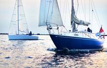 Blue Sloop Rigged Sailboat And...