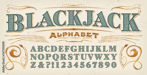 A Vintage Style Font; Blackjack Alphabet with Additional Gold Flourishes Fotobehang