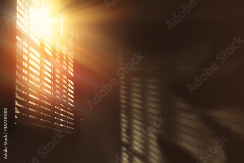 Sun shining through window blinds in room - 367394018