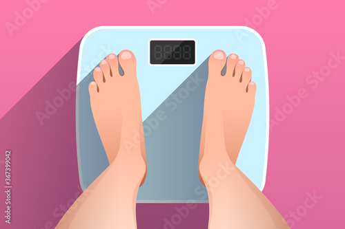 Fototapeta Top view of feet of woman standing on bathroom scales obraz