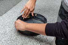 Hands Greasing A Cake Pan