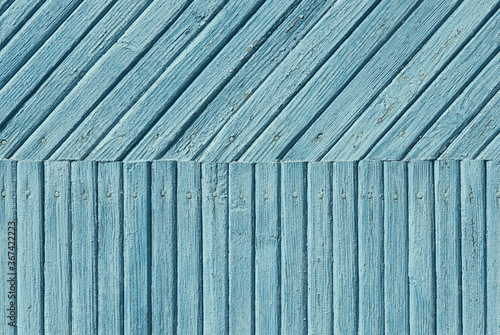 Valokuvatapetti dim blue abstract background of wooden planks with cracked paint texture
