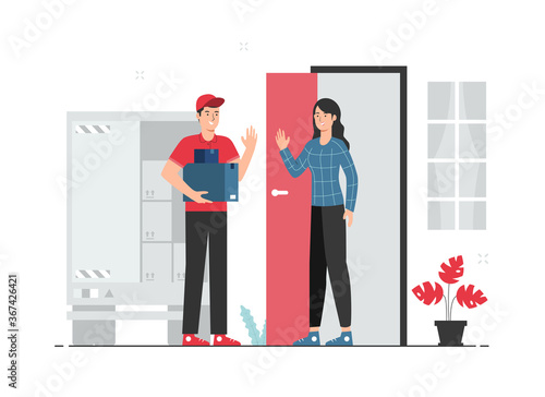 Obraz Delivery service concept. Male courier delivering packages to female customer's home - fototapety do salonu