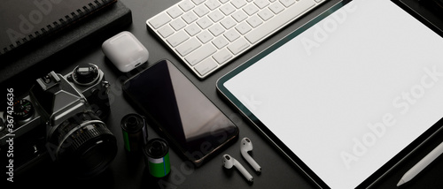Digital devices on dark table with mock up tablet, smartphone, camera and office Canvas Print