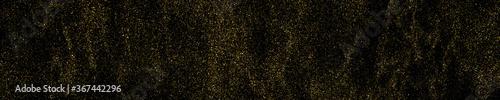 Fototapeta Gold glitter texture isolated on black. Amber particles color. Celebratory panoramic background. Golden explosion of confetti. Long horizontal banner. Vector illustration, EPS 10. obraz