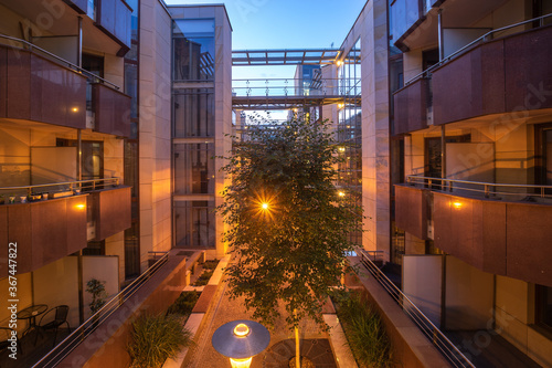 modern apartment building made of glass and steel and enriched with trees and fl Canvas-taulu