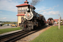 A Smoke Steam Locomotive Operated By The Strasburg Rail Road Stops And Awaits Departure At The Train Station In Strasburg, Lancaster County, Pennsylvania.
