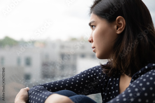 Obraz Sad Asian millennial girl look in window distance thinking or pondering alone at home, thoughtful upset unhappy Vietnamese woman lost in thoughts dreaming, feel lonely distressed, loneliness concept - fototapety do salonu